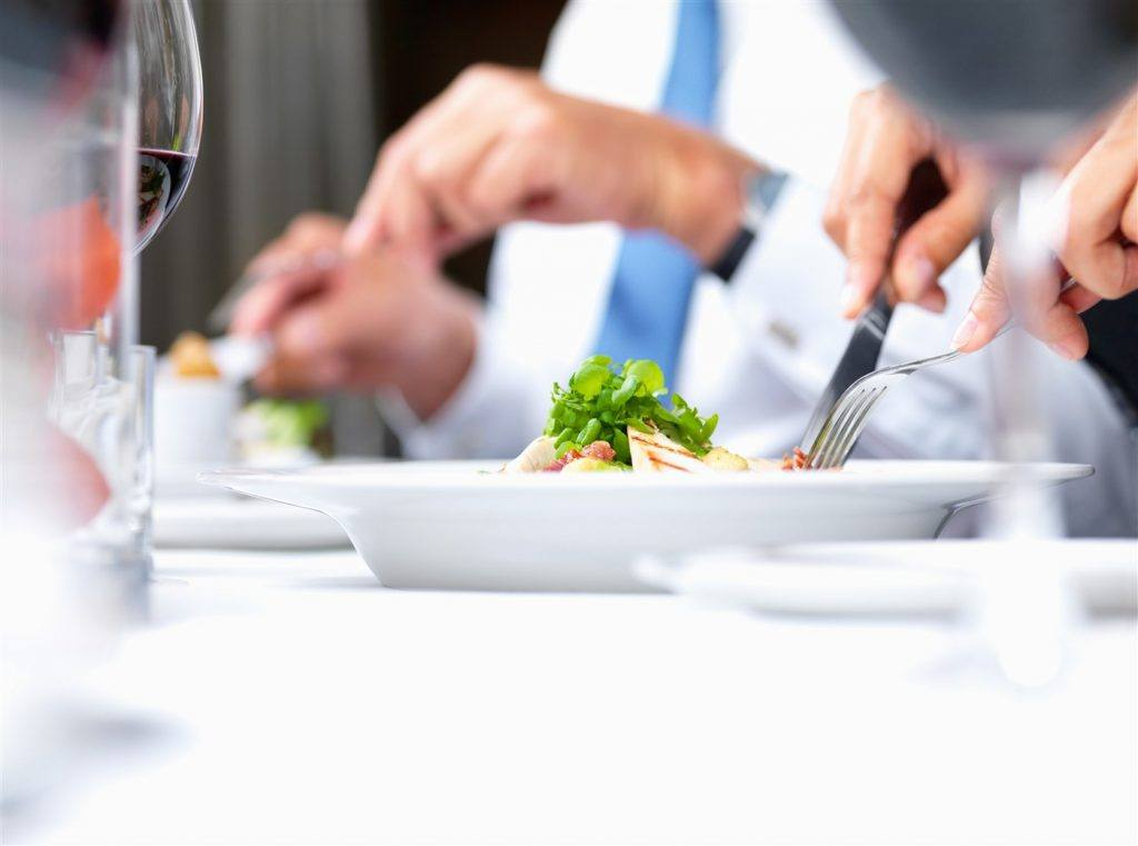 An image of customers enjoying a meal from the Avala website