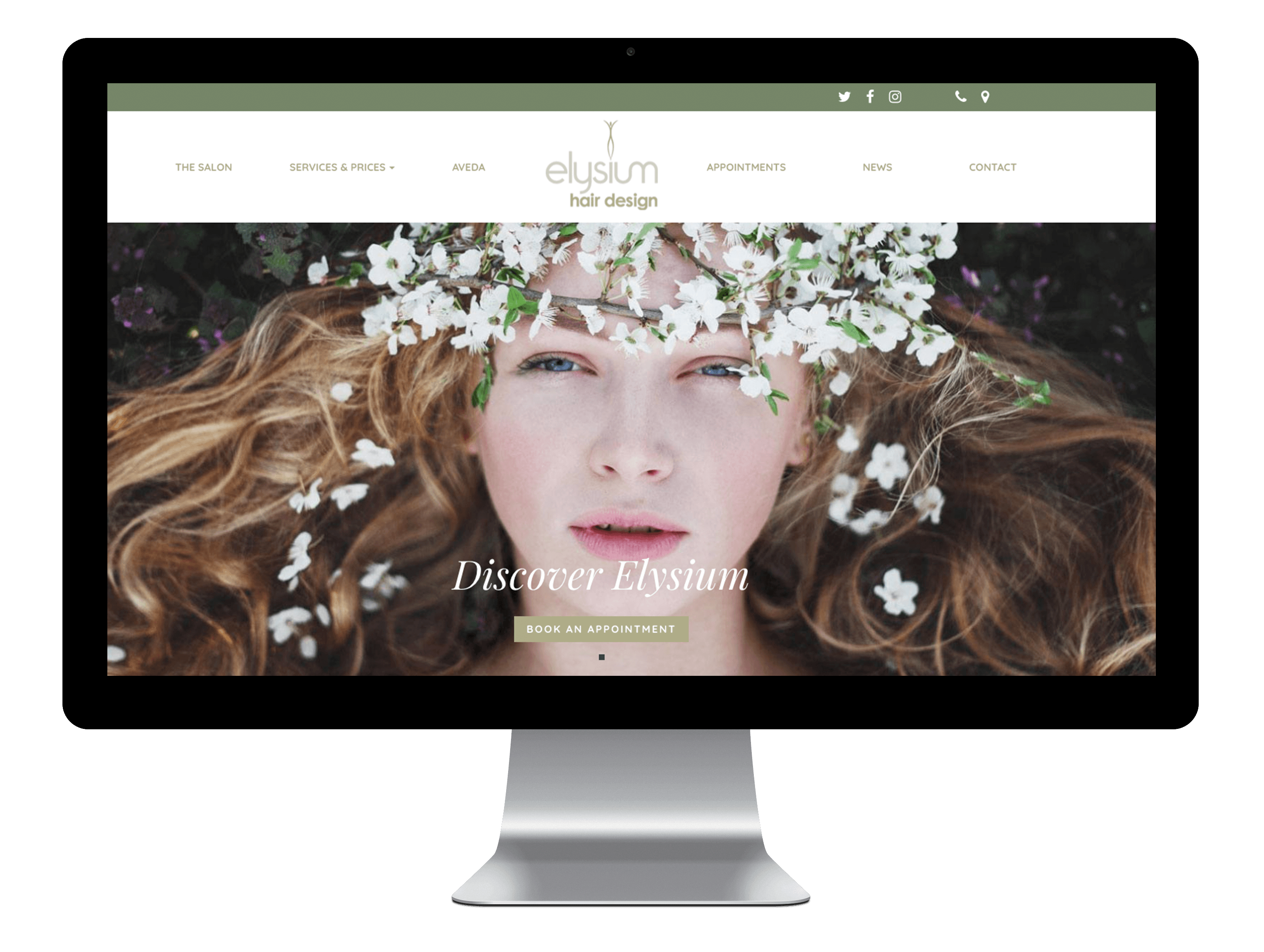 The Elysium Hair Design website displayed on a Mac screen